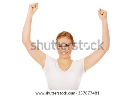 Young happy woman with arms up. - stock photo