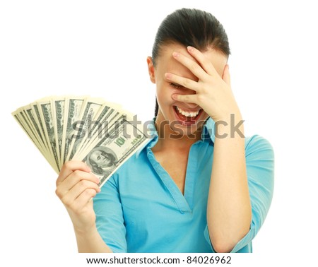 Young happy woman with dollar notes not believing in her success. Isolated on white background.