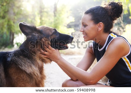 Young happy woman with is Belgian Malinois dog. - stock photo