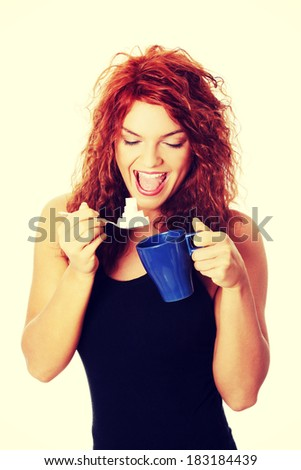 Young happy woman with lot of sugar - stock photo