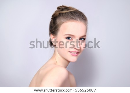 Young happy woman with natural makeup and a beautiful smile