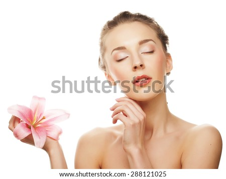 young happy woman with pink orchid - stock photo