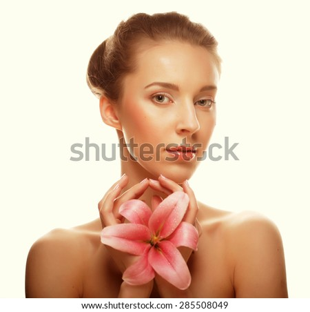 young happy woman with pink orchid isolated on white - stock photo