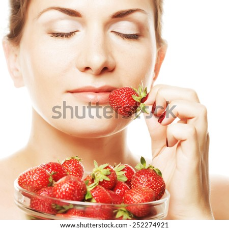 young happy woman with strawberry - stock photo