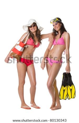 Young happy women in swimsuit - stock photo