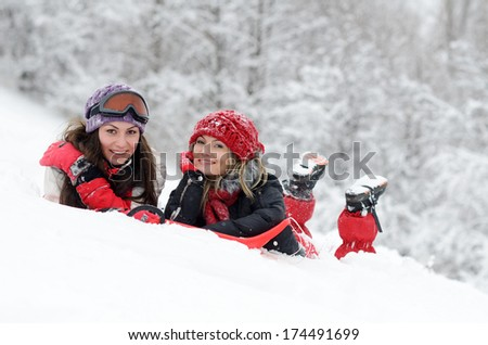 young happy women outdoor in winter enjoying the snow - stock photo