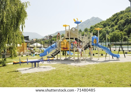 young hapy family portrait at park playground - stock photo