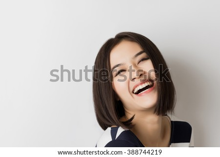 Young healthy Asian short hair woman with smiley face. - stock photo