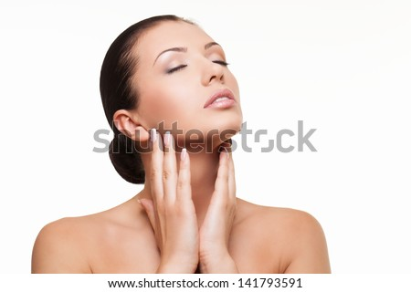 Young healthy beautiful brunette with eyes closed caressing her neck - stock photo