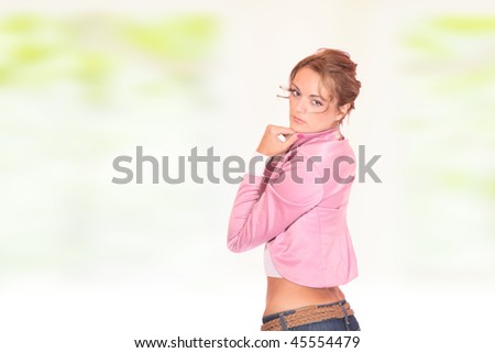 Young healthy beautiful spring woman in over light green background
