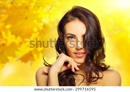 Young healthy girl on autumnal background - stock photo