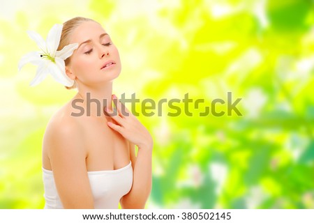 Young healthy girl on spring floral background - stock photo