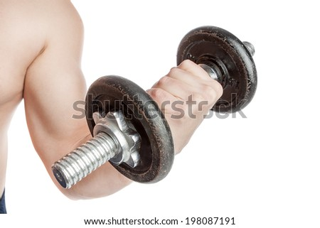 Young healthy guy with a dumbbell. Doing biceps. - stock photo