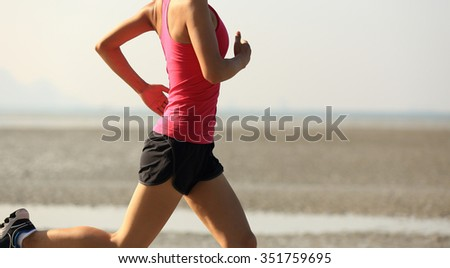 young healthy lifestyle woman running on beach - stock photo