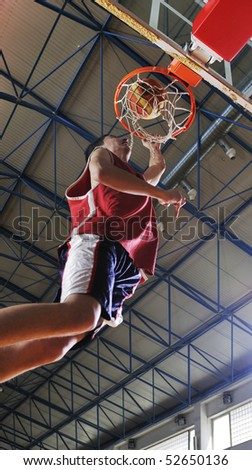 young healthy man play basketball game indoor in gym - stock photo