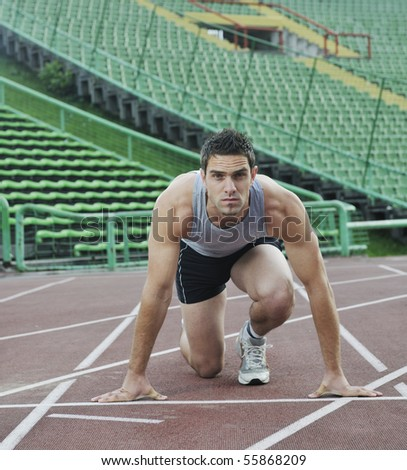 young healthy man run on athletics race sport track and representing concept of sport and speed
