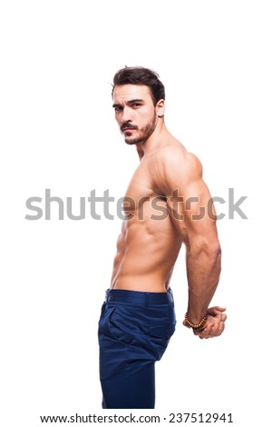 young healthy model with atletic body showing his triceps, on white background - stock photo