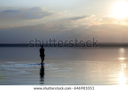 Young healthy woman dancing, walking, running, practicing yoga fitness exercise on the beach at sunset. Healthy lifestyle concept. Copy space text.