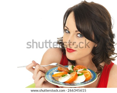 Young Healthy Woman Eating a Mozzarella Cheese and Tomato Salad - stock photo