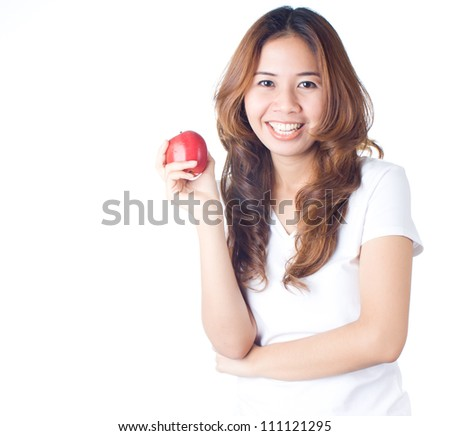 Young healthy woman holding the red apple on white background, healthy eating concept - stock photo