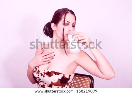 young healthy woman is drinking milk from a glass - stock photo