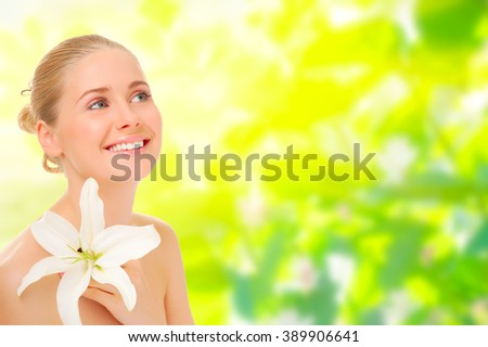 Young healthy woman on spring floral background - stock photo