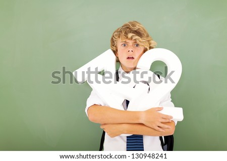 young high school student feeling hopeless in mathematics subject - stock photo