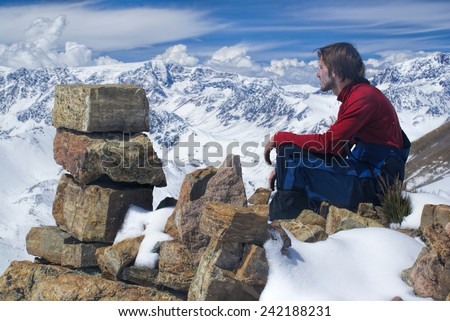 Young hiker admiring view in south american Andes in Peru, Ausangate - stock photo