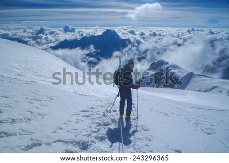 Young hiker descending from top of Huayna Potosi mountain in Bolivia - stock photo