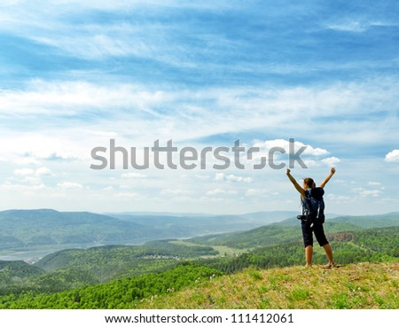 Young hiker on the hilltop. - stock photo
