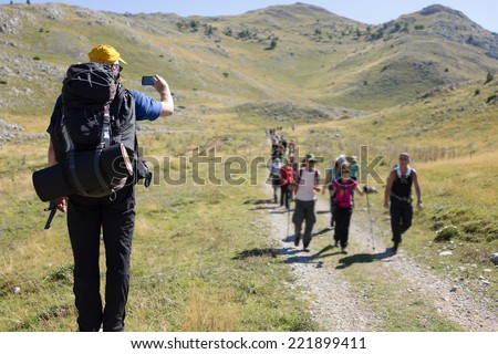 Young hiker with backpack and boots - stock photo