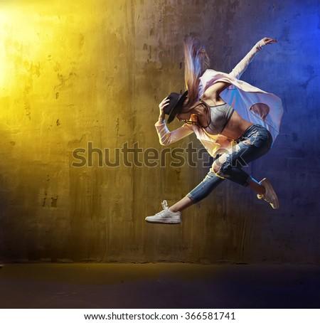 Young hip-hop dancer jumping - stock photo