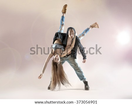 Young hip hop dancers, on studio background - stock photo