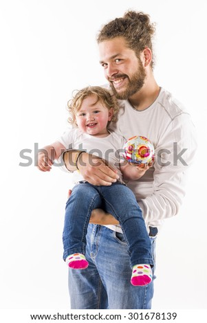 Young hip man with beard holding his sweet little old daughter in her arms, isolated against a white background. - stock photo