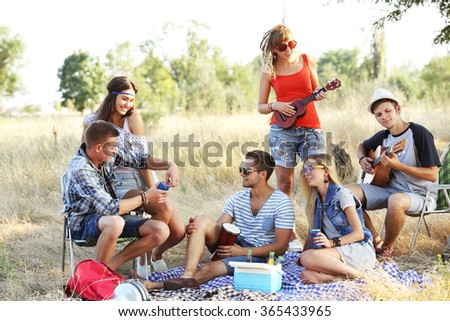 Young hippie people relaxing in the forest outdoors - stock photo