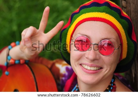 Young hippie woman making peace sign - stock photo