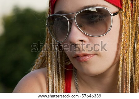 Young hipster girl posing outdoors - stock photo