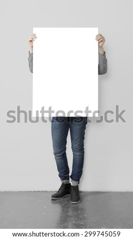 young hipster holding blank poster - stock photo