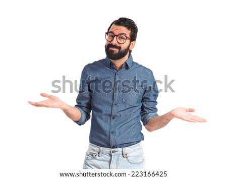 Young hipster man having doubts over white background   - stock photo