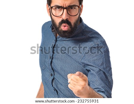 Young hipster man pointing and shouting