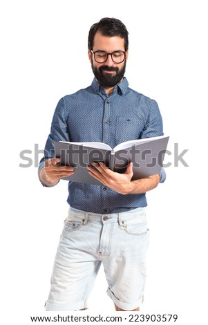 Young hipster man reading a book - stock photo