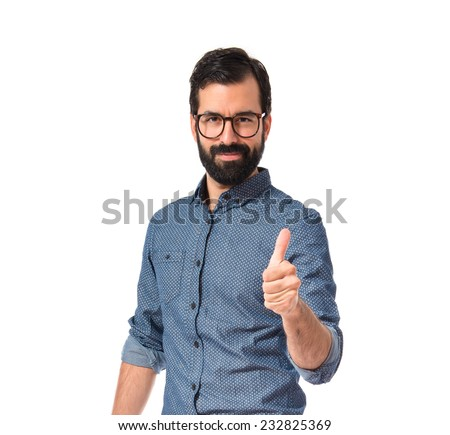 Young hipster man with thumb up - stock photo