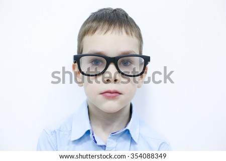 young hipster. Portrait of a serious boy in glasses with black frames - stock photo