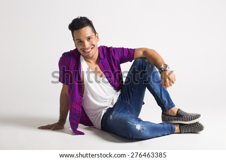 Young hipster posing at the studio - stock photo