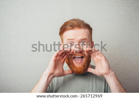 Young hipster red bearded Manshouting with  beard and freckles - stock photo