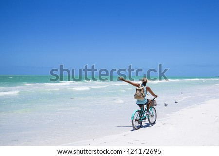 Young hipster using his smart phone on holidays in Mexico. - stock photo