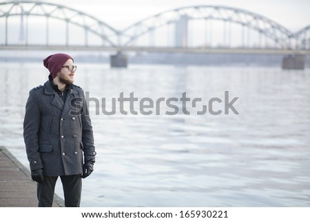 Young hipster with moustache and beard in Riga - stock photo