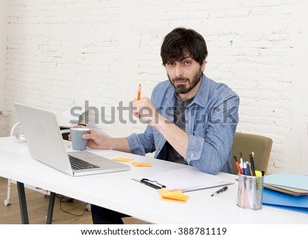 young hispanic attractive  hipster 30s businessman working busy at modern home office with computer laptop dressing casua denim in creative freelancer business success concept - stock photo