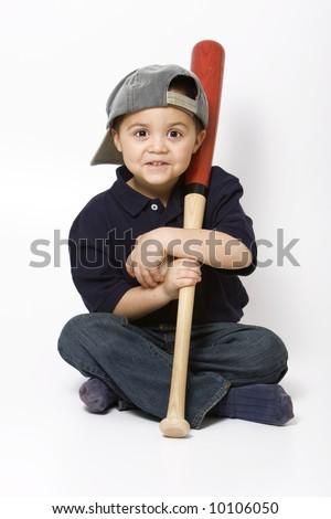 Young hispanic boy with a baseball bat and ball - stock photo