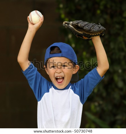 Young hispanic boy with baseball and glove celebrates - stock photo